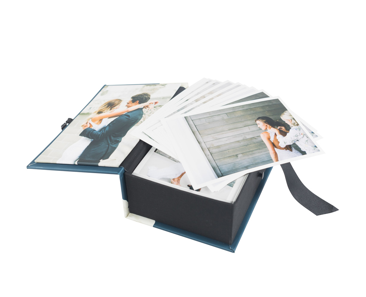 Custom photo boxes start at $225 and hold between 100 to 400 premium lustre or deep matte prints. Sizes range from 4x6, 5x7, 6x6, 8x8 & 10x10 inches.