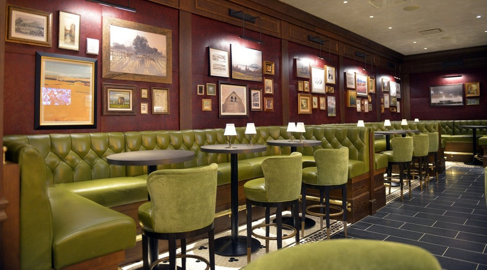 The Chandler Steakhouse - Location: MGM Resort and Casino, Springfield, MAType: Restaurant & BarSize: 8000 sq ftLocated in the new MGM Resort and Casino in Springfield, MA, The Chandler Steakhouse is the property's premier fine dining restaurant. Drawing inspiration from the collection of historic downtown buildings incorporated into the resort and referencing Springfield as the home of Websters Dictionary; The Chandler features traditional wood paneling and brass accents throughout. The upholstered and heavily distressed red leather walls are reminiscent of a worn leather bound book and provide a striking contrast to the layers of art that reference the history of the local community.