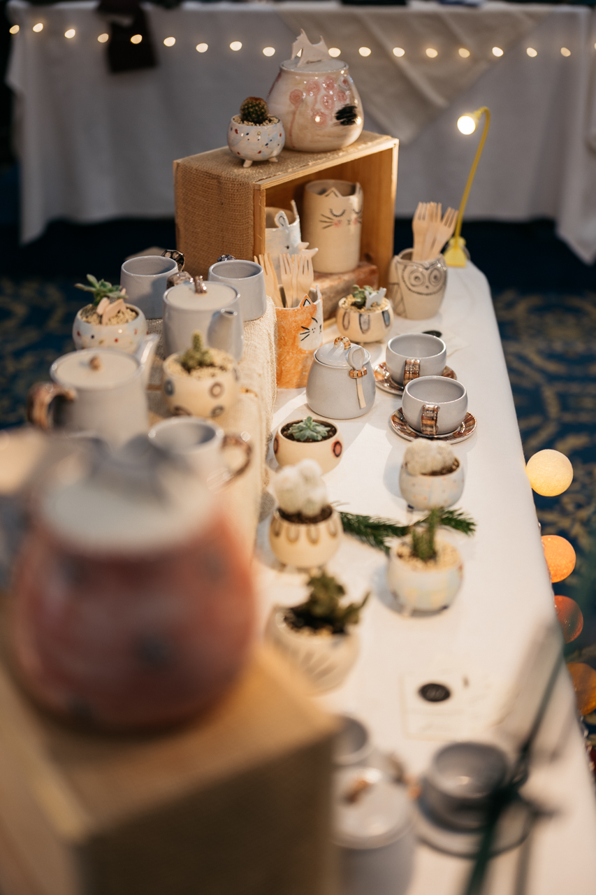An image of some of my stoneware creations (Scottie cookie jars, teapots, spoon holders, etc.), displayed at a Christmas event in Florence, Italy.  Photographed by Andrea Prologo