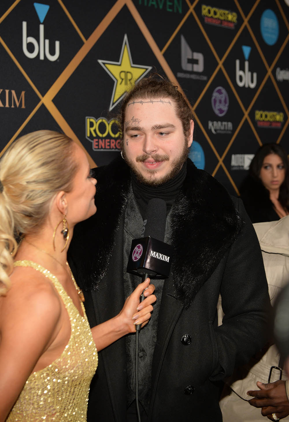 Post Malone arrives at the 2018 Maxim Super Bowl Party.