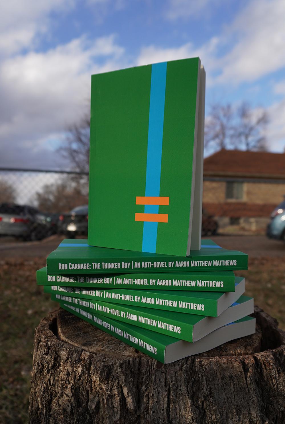 ron-carnage-books-on-stump.jpg