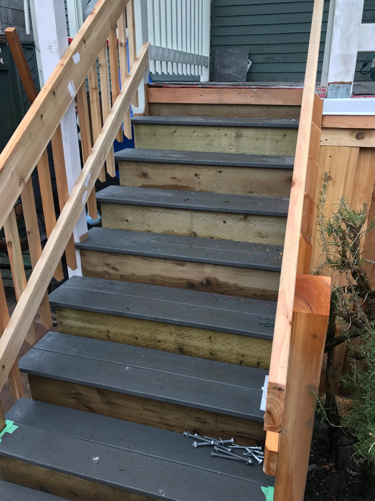New cedar railing and composite treads.