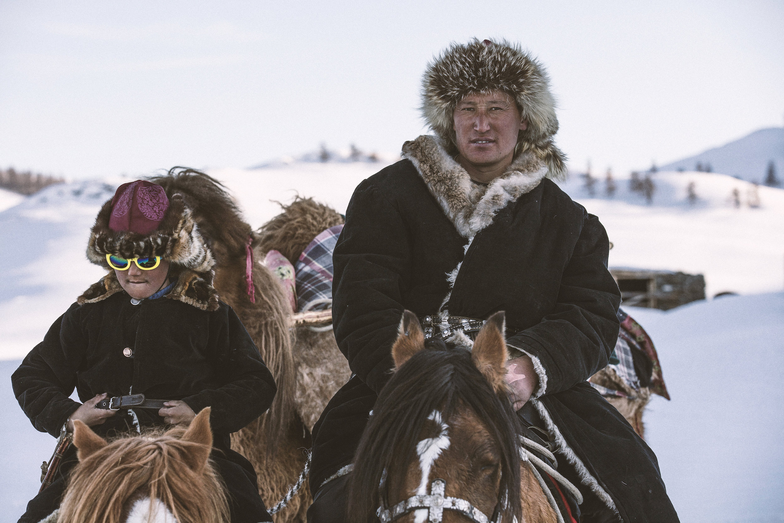 Janibek (L) with his father Auez on the winter migration, Mongolia Altai_BOY_NOMAD_aAron_Munson.jpg