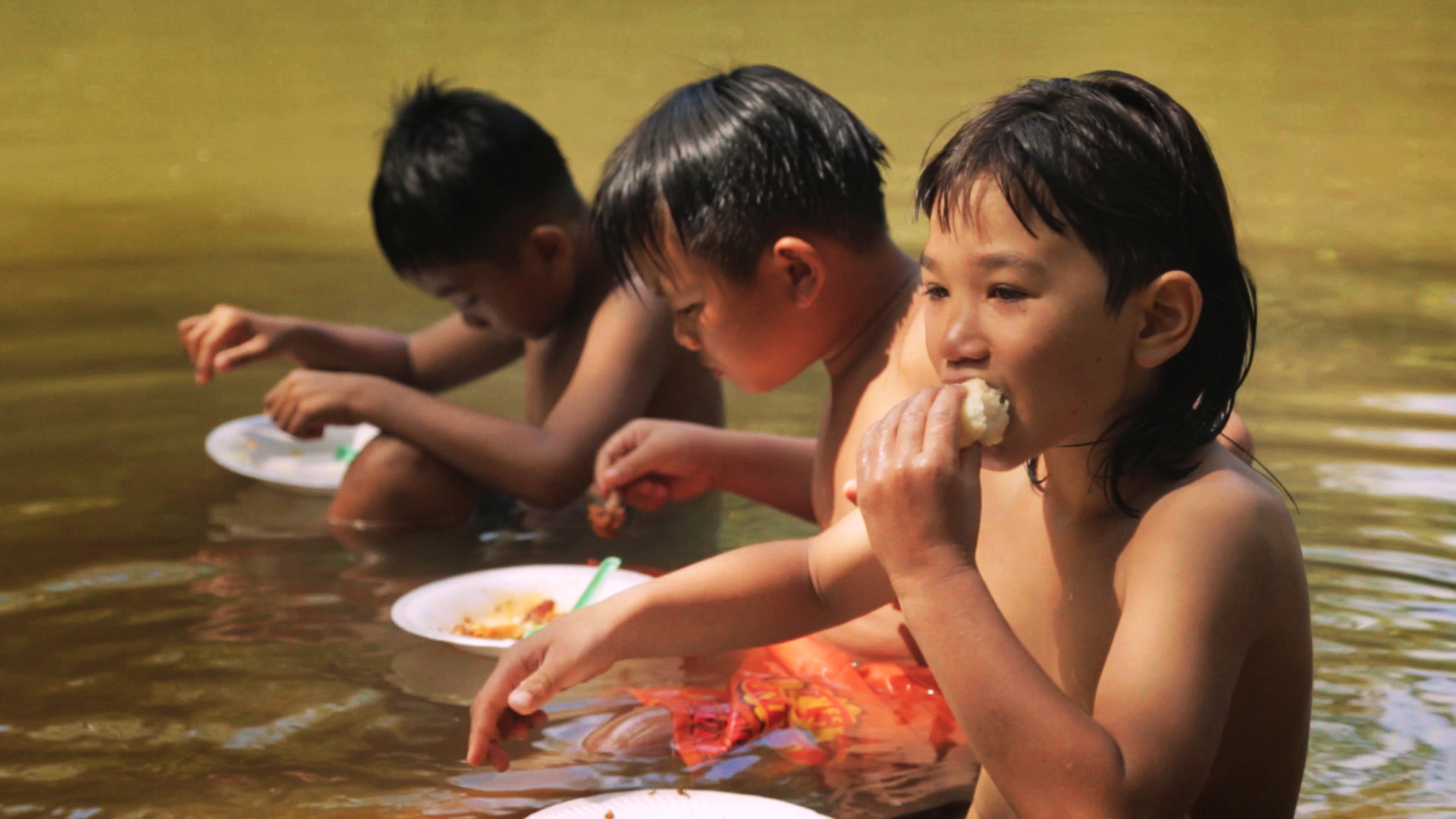 ATimeToSwim_film still_Agan and cousins on the river_photo by Vincent Gonneville.jpg