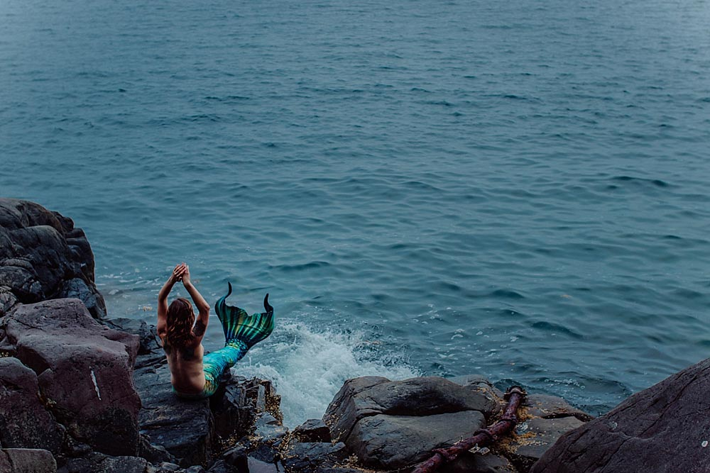 alaskian-mermaid-sits-on-rocky-shore-in-juneau-alaska.jpg