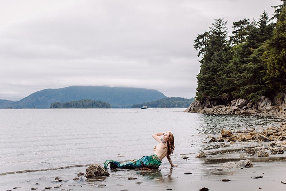 tattooed-mermaid-sits-on-alaskian-beach.jpg