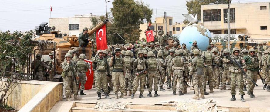 Turkish soldiers gather in the Kurdish-majority city of Afrin, via Getty