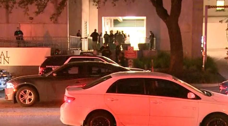 Police gather around Memorial Hermann Hospital.