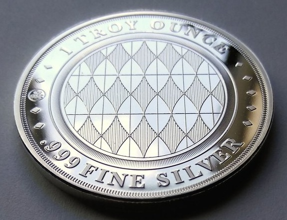 Reverse side: The prize given quarterly, a one ounce .999 fine silver 'Constance' round by The Phaup Company, llc.