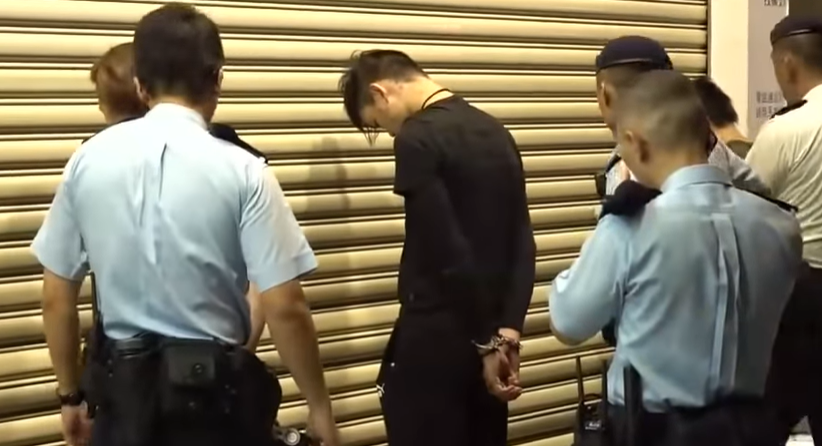 A protester is arrested in Hong Kong.