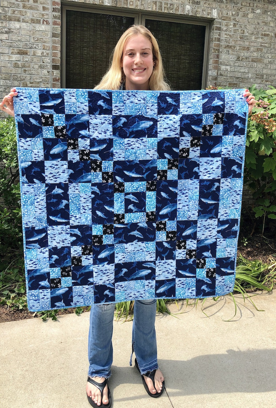Winona and her Shark baby quilt for Junia.