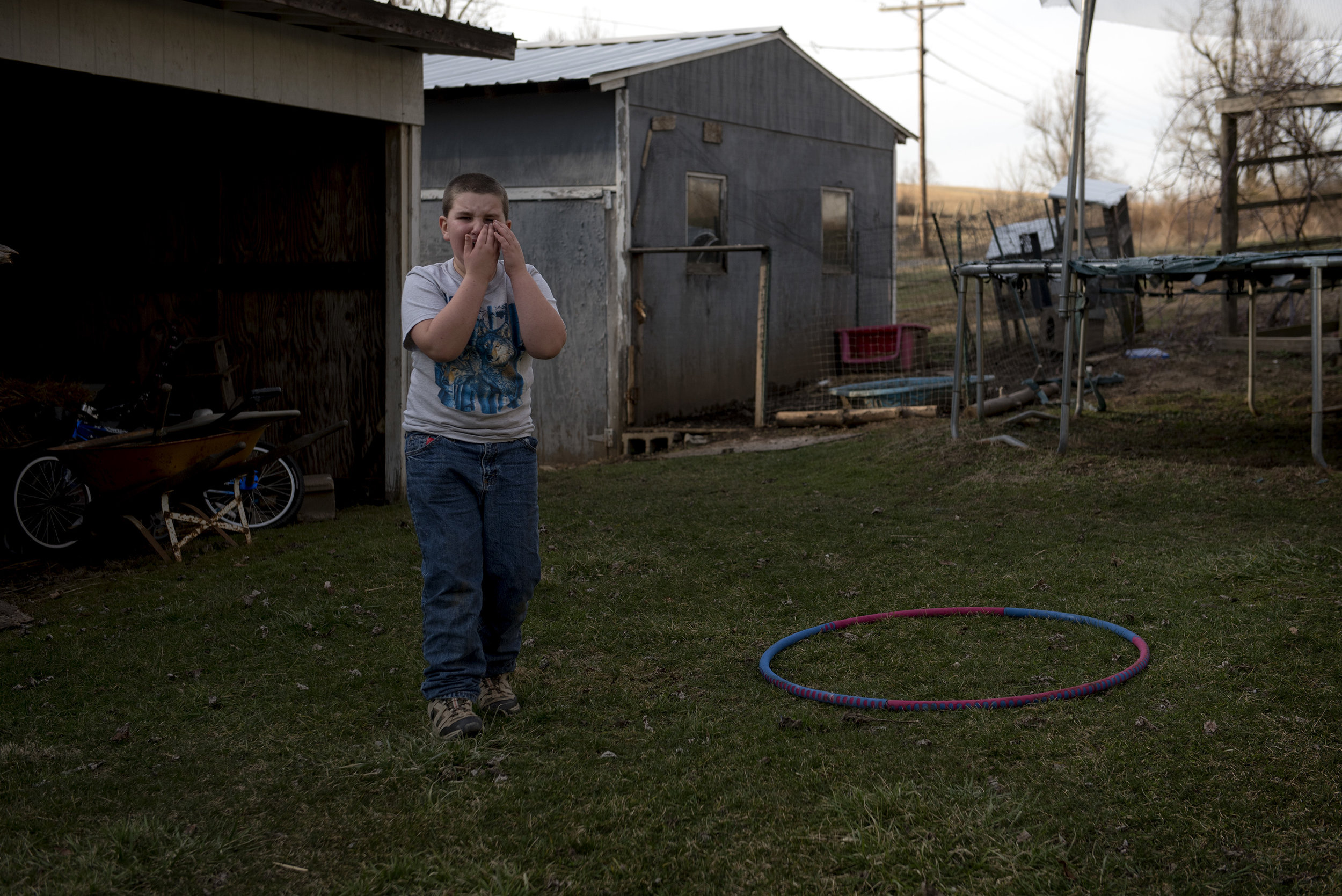 "Nathan Trout holds his face in tears after his cousin once-removed kicked the hula hoop up at his face on accident. ""You know how some boys are real tough? Nathan's not one of them,"" said his mother. Masculinity is often defined by the a sense of hard-working, tough, nose-to-the grindstone work ethic. Being able to work hard and support yourself and family are held as strong values in manhood."