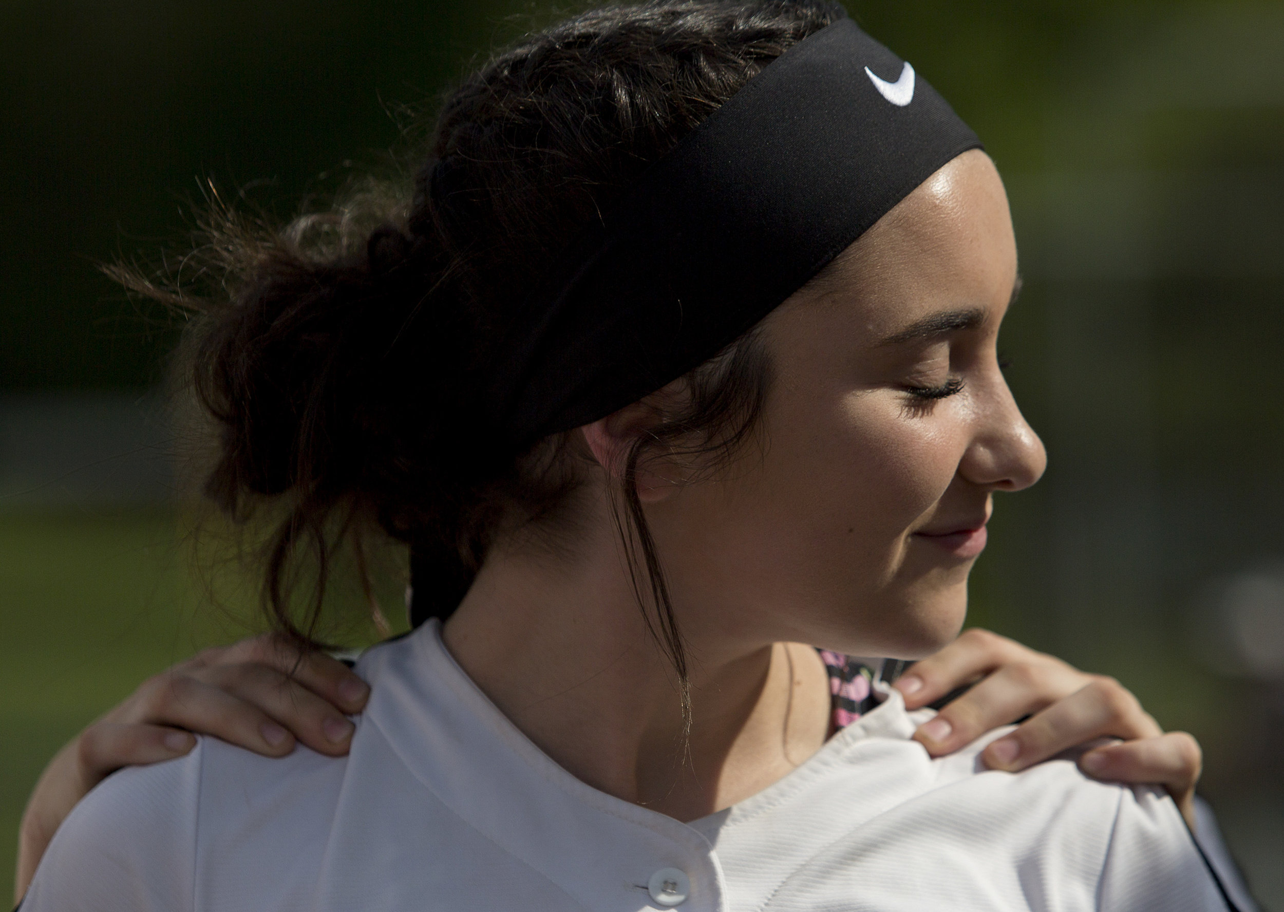 Northeast Dubois' Haley Reckelhoff got a shoulder rub from teammate Madison Voegerl before facing South Knox in Dubois on May 10, 2018. Northeast Dubois won 8-0.