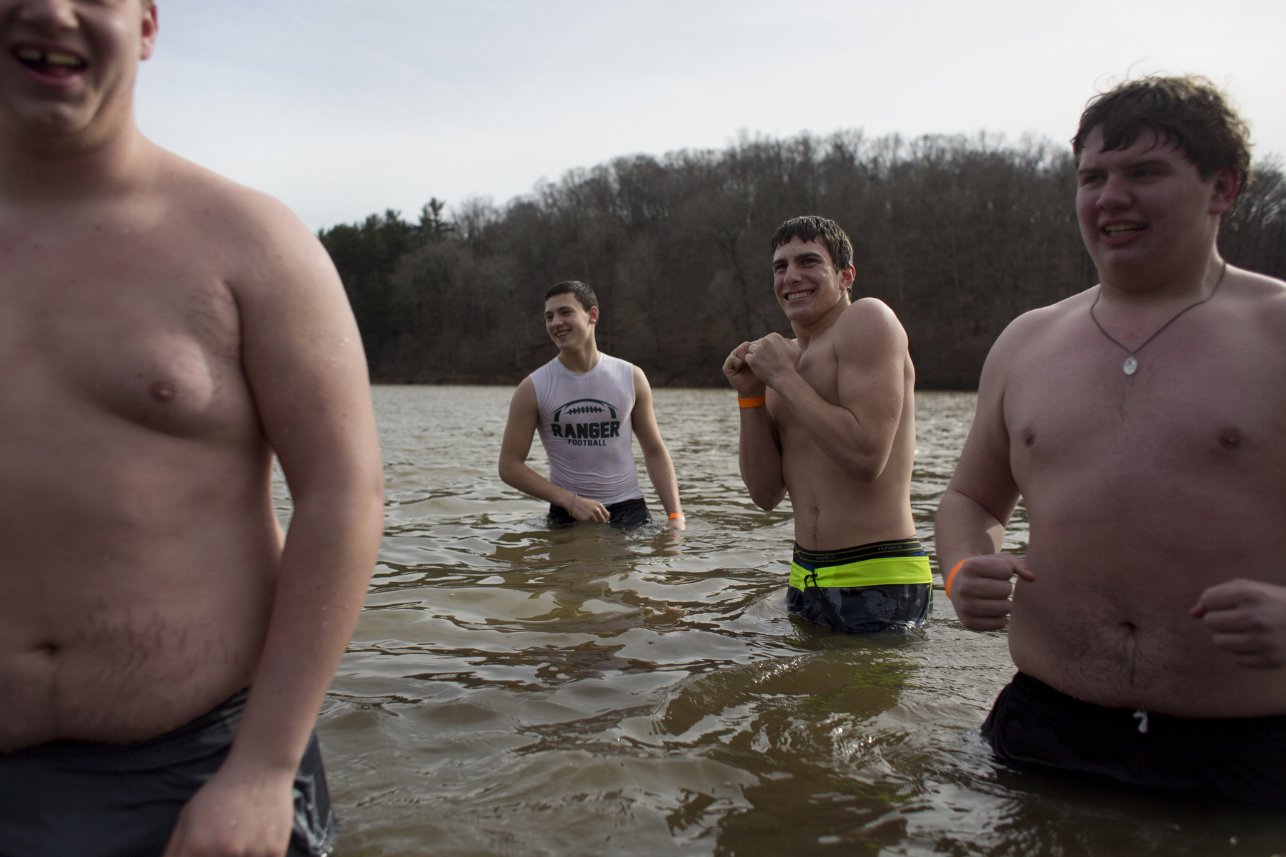 """Forest Park football players Zach Lueken of St. Anthony, 17, right, Garret Berg of Ferdinand, 16, Cory Uebelhor of Ferdinand, 15, and Brennan Weyer of Ferdinand, 16, held a contest to see who could stay in the 37-40-degree water the longest after the seventh annual polar plunge at the Ferdinand State Forest in Ferdinand on Sunday. Uebelhor won the contest and Berg placed second. """"As soon as I got in, my legs went numb,"""" said Berg."""