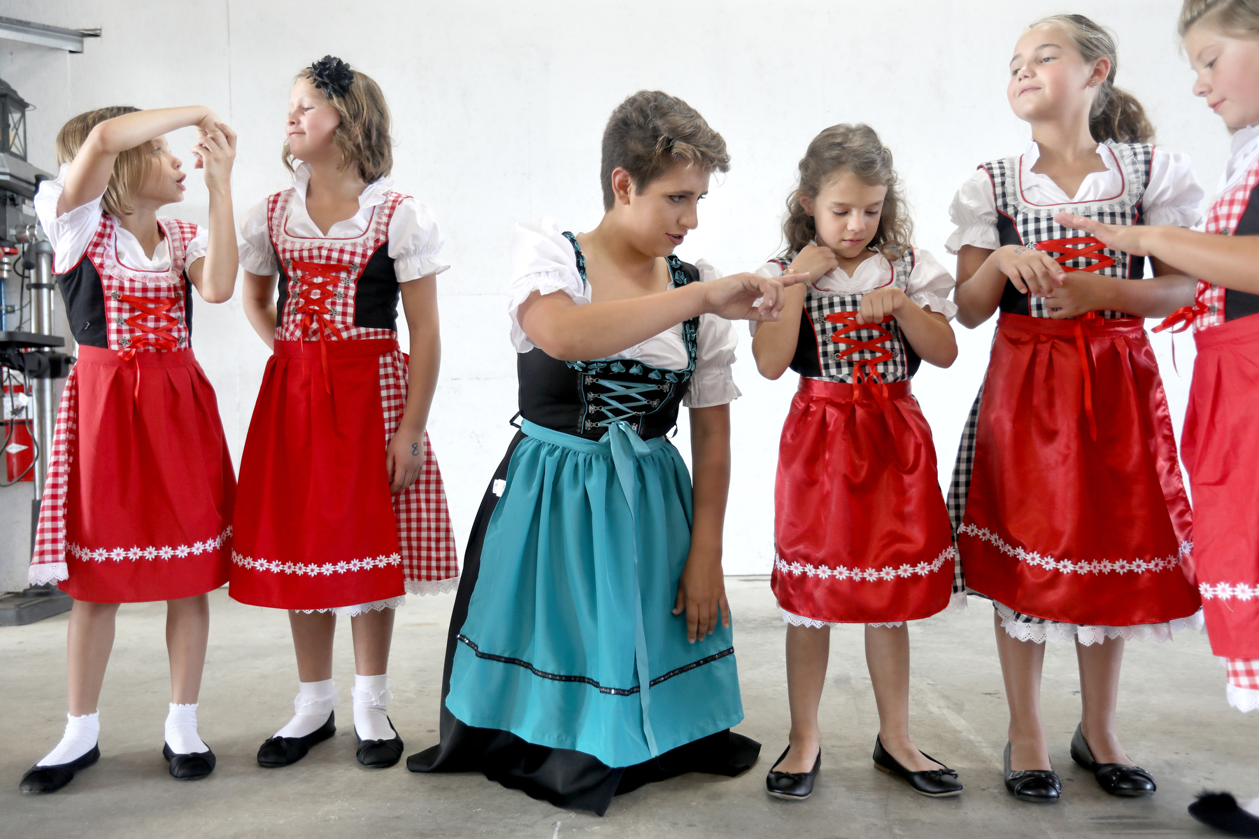 """Before practicing the Mai Pole Dance for the 40th Strassenfest Wednesday evening, Ella Wagner, 8, left, Briley Porter, 8, Breann Lechner, 17, Emilie Recker, 6, Isabella Kluesner, 8, and Lauryn Truesdale, 8, all of Jasper, read the numbers written on their hands that corresponded to starting positions in the dance at the Ackerman Oil Shop in Jasper. Jasper German Club treasurer Laura Grammer of Jasper looked forward to """"seeing the smiles on the faces of these kids as they enjoy German Heritage events that their ancestors might have enjoyed hundreds of years ago."""""""