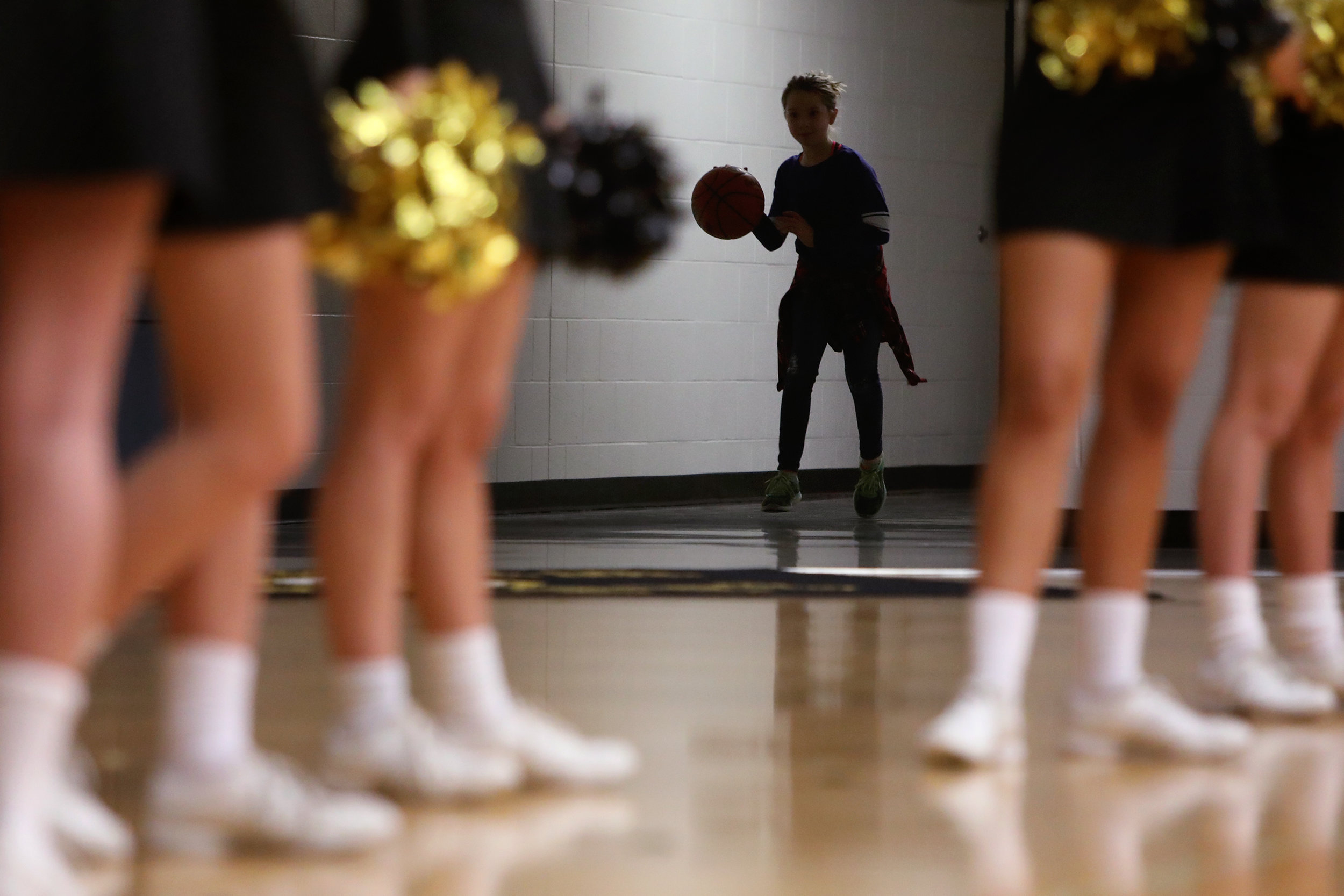 Jaida Kendall of Jasper, 10, played in the hallway as the Wildcats faced the Princeton Tigers at Jasper High School in Jasper on Tuesday. Kendall is the daughter of Jasper assistant coach Phil Kendall.