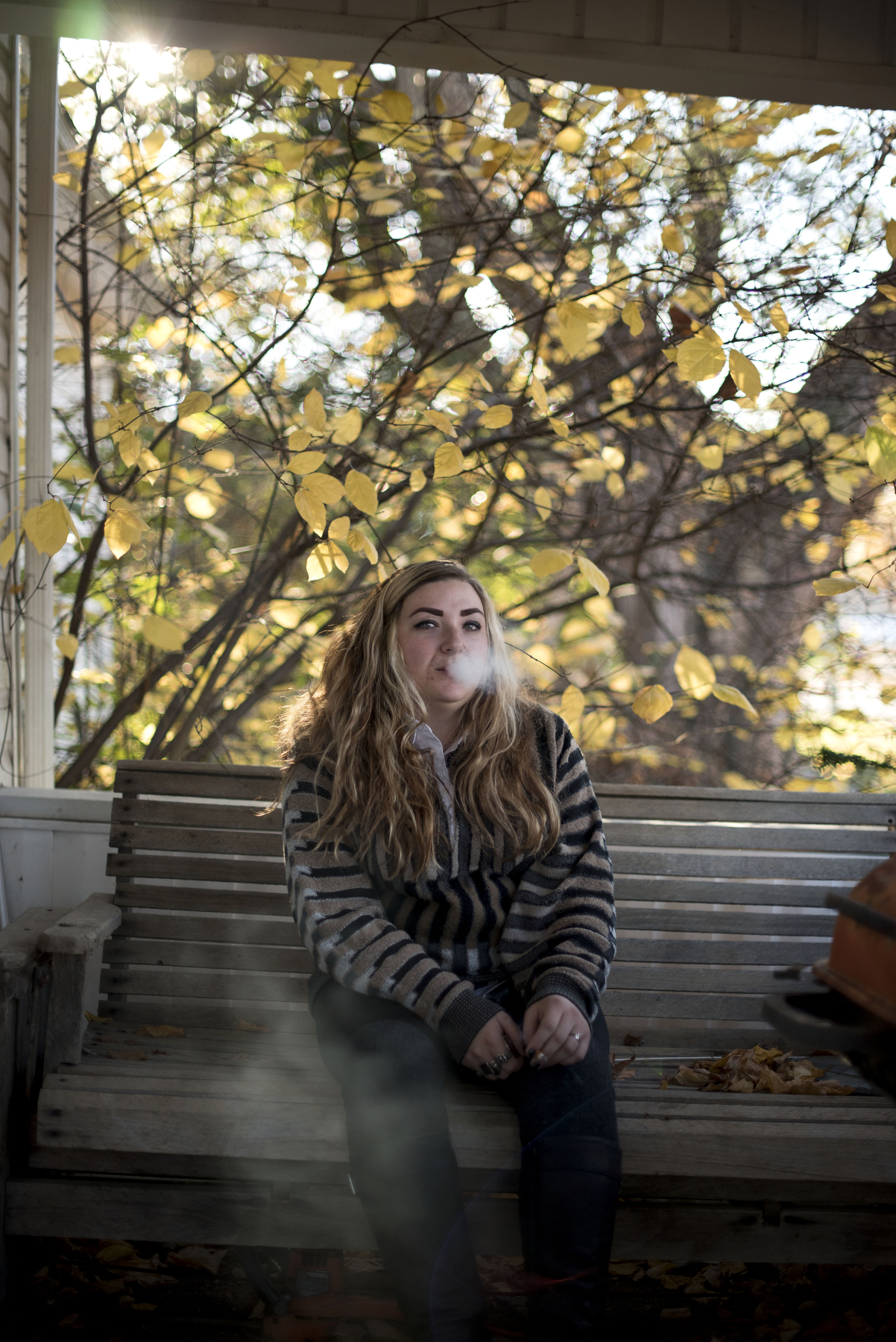 Kaylee Perkins poses for a portrait on the porch of her boyfriend's house in Coolville, Ohio on Nov. 5, 2016. Perkins works at the Uptown Grill in Athens, Ohio.