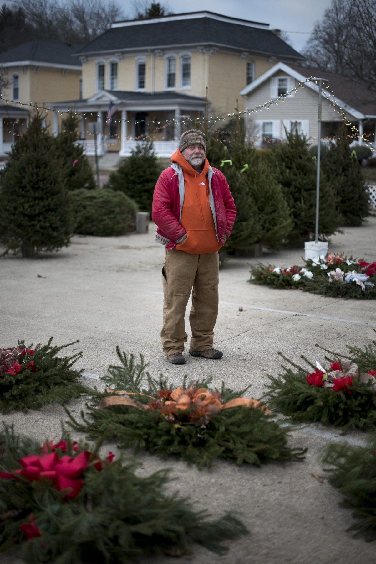 John Oakley, of Nelsonville, Ohio, stands in front of the grave blankets that he and his wife made as a fundraiser for the First Presbyterian Church of Nelsonville on Dec. 9, 2016. Oakley's wife worked as a florist for more than 30 years, and Oakley has helped his wife make grave blankets for the past couple years.