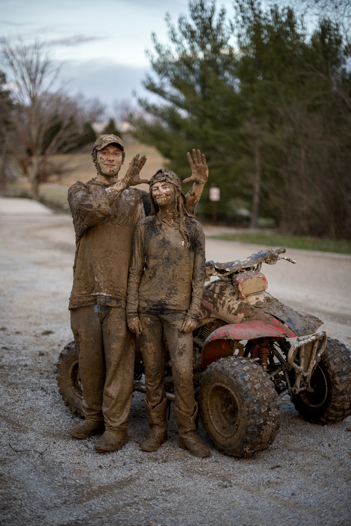Cameron Powell and Ivy Meeks stand in the parking lot of the Shade Community Center after a mud fight in the woods in Shade, Ohio on Feb. 23, 2017.