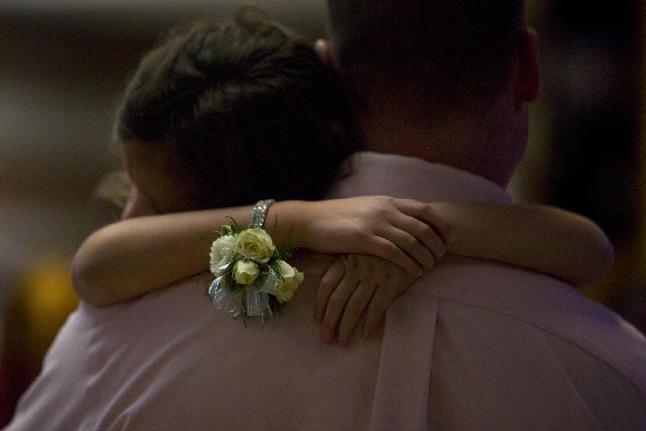 "Julia Pryor of Jasper, 5, rests her head on her father Matt's shoulder while slow dancing at the daddy-daughter dance at Jasper Middle School on January 6, 2018. Julia is the youngest of three daughters, and Matt has brought his other daughters in previous years. ""This is her first [daddy-daughter dance]. She's had to wait patiently, and she finally got dad to herself,"" said Matt."