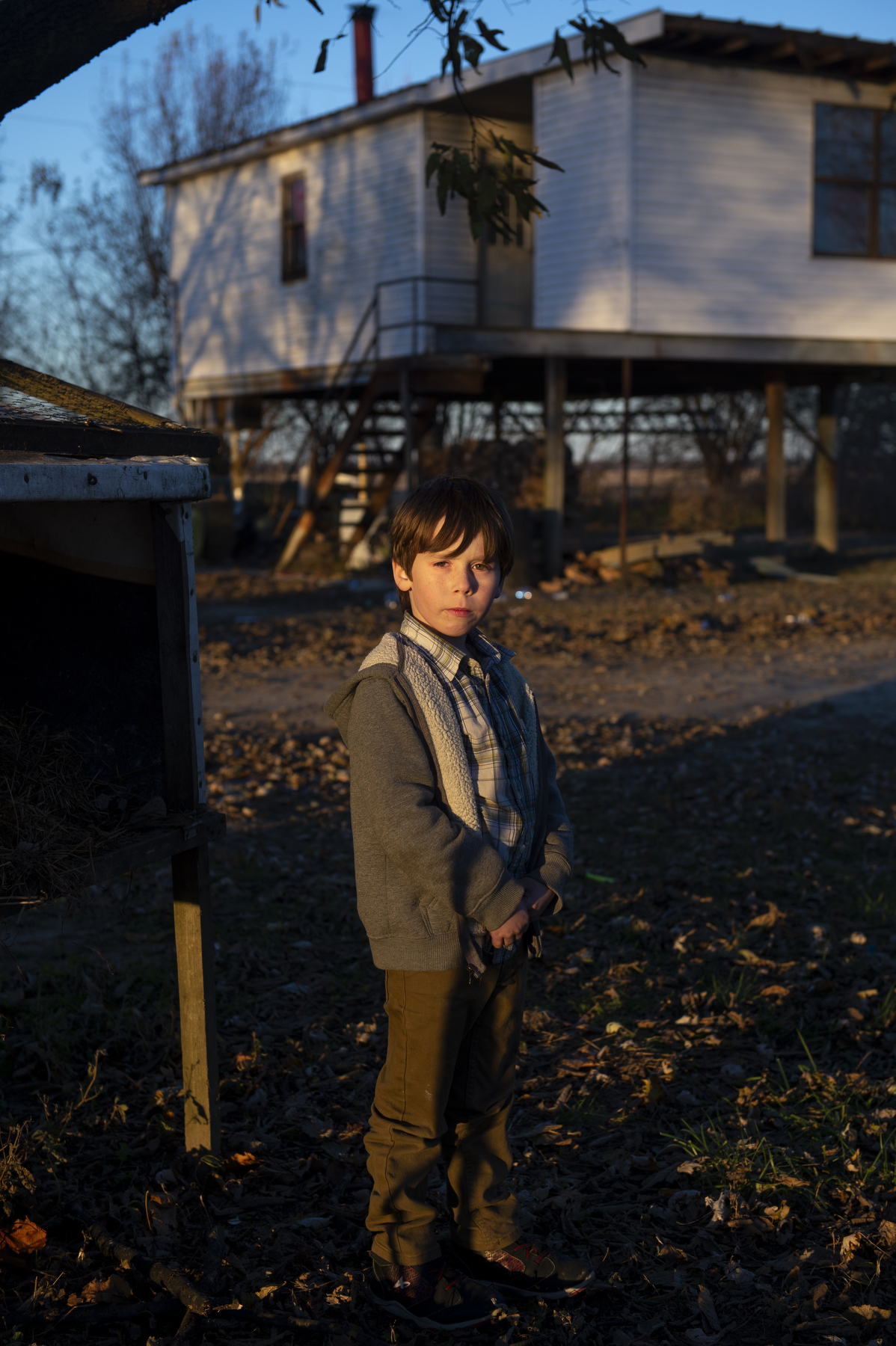 "Xavier Short, 7, has spent much of his childhood visiting and staying with his grandfather Joe Short, who lives at the riverbank year-round in the home pictured in Dade, Ky. on Nov. 25, 2017. Xavier likes the feeling of being ""in the wild"" that he has at the riverbank. ""There's wild all around you like the trees and leaves and grass… the trees change from dark green to light green, and even red to orange to yellow,"" Xavier said. ""Mother Nature changes."""