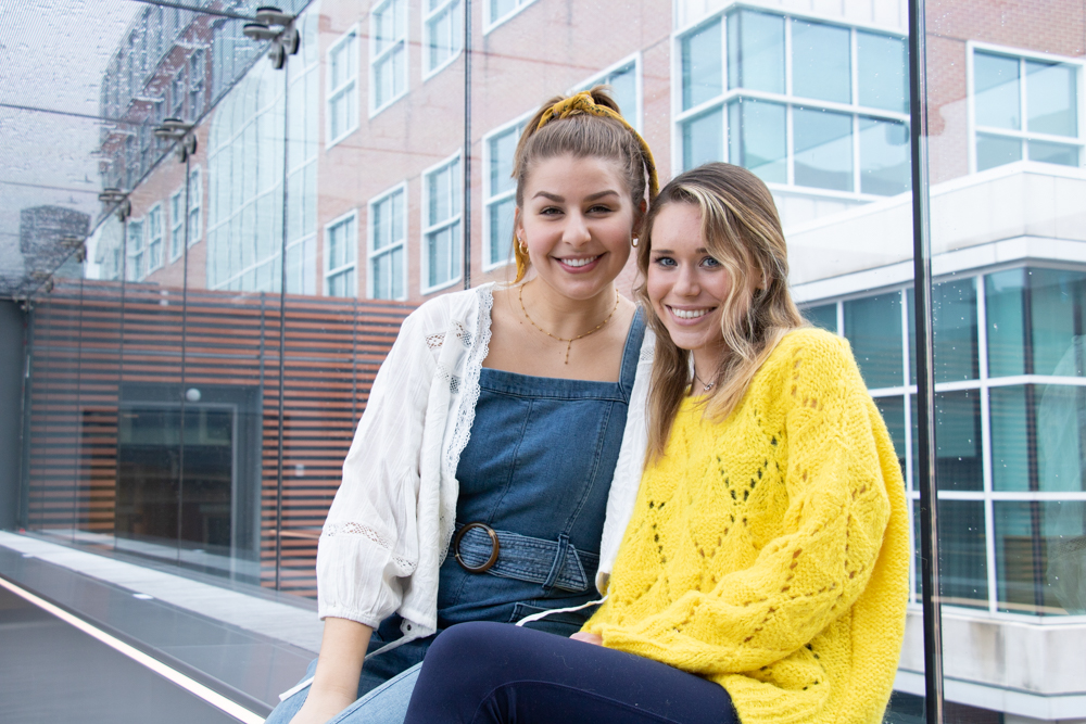 Sarah Madaus (REFINE Editor-in-Chief) and Claire Wolters (Intersection Editor) photographed in the Alter Hall Skywalk. | HANNAH PITTEL / REFINE MAGAZINE