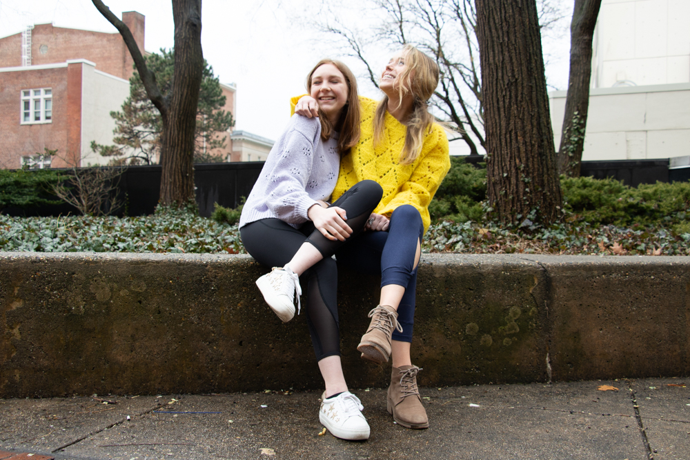 Intersection Editor Claire Wolters (right) embraces her best friend Ally Mirin, a Cornell University junior, on Sunday on Liacouras Walk. | HANNAH PITTEL / REFINE MAGAZINE