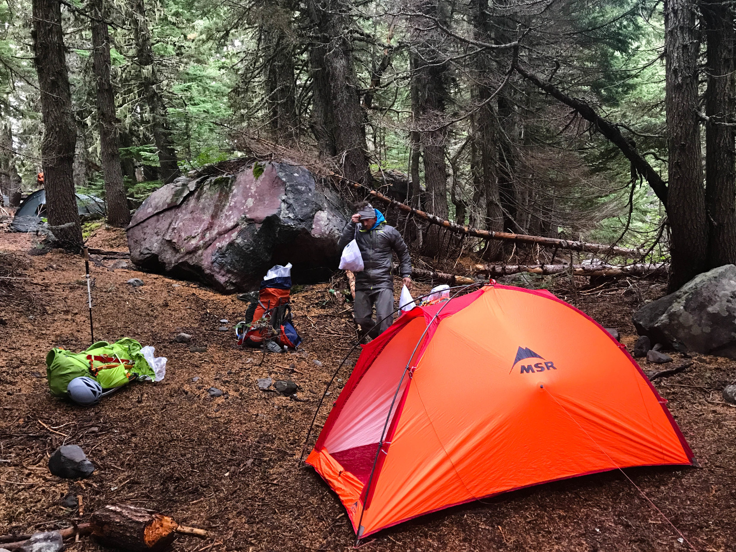 Mirkwood Camp- Camp 1 was at treeline just under the toe of the Coleman Glacier at 4600 feet. Recent rains soaked everything, requiring trenching around tents to keep them from flooding.