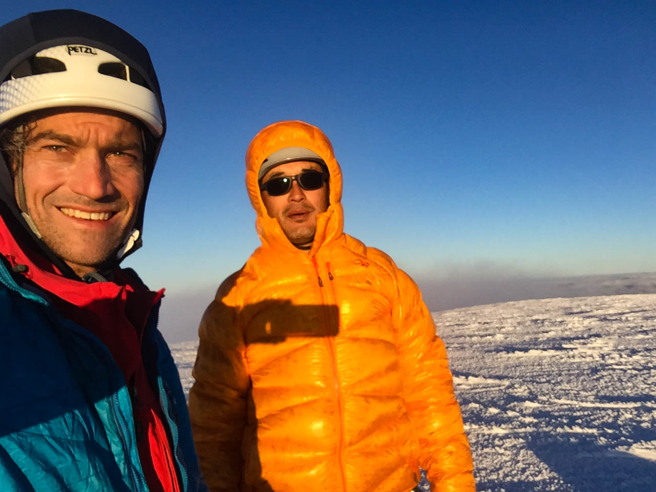Grant Peak Summit - This is what it looks like to be physically exhausted, cold and whittled down by pain. Mark Allen, left, is faring much better. Photo: Mountain Bureau, LLC