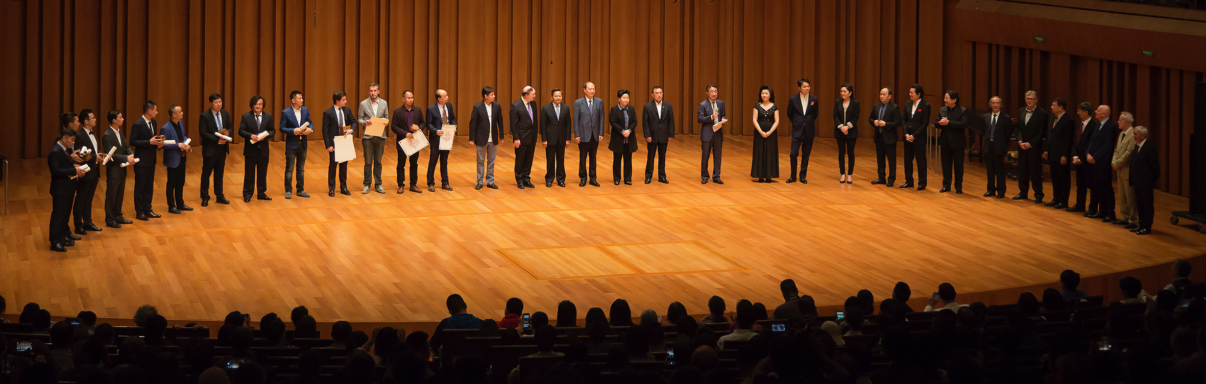 Award winners of the 4th China International Violin and Bow Making Competition on stage at the National Centre for the Performing Arts (NCPA) in Beijing.
