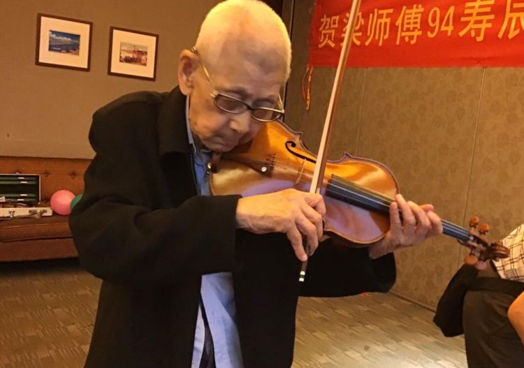 Master Chinese Violinmaker Liang Guohui plays a violin on the occasion of his 95th birthday.