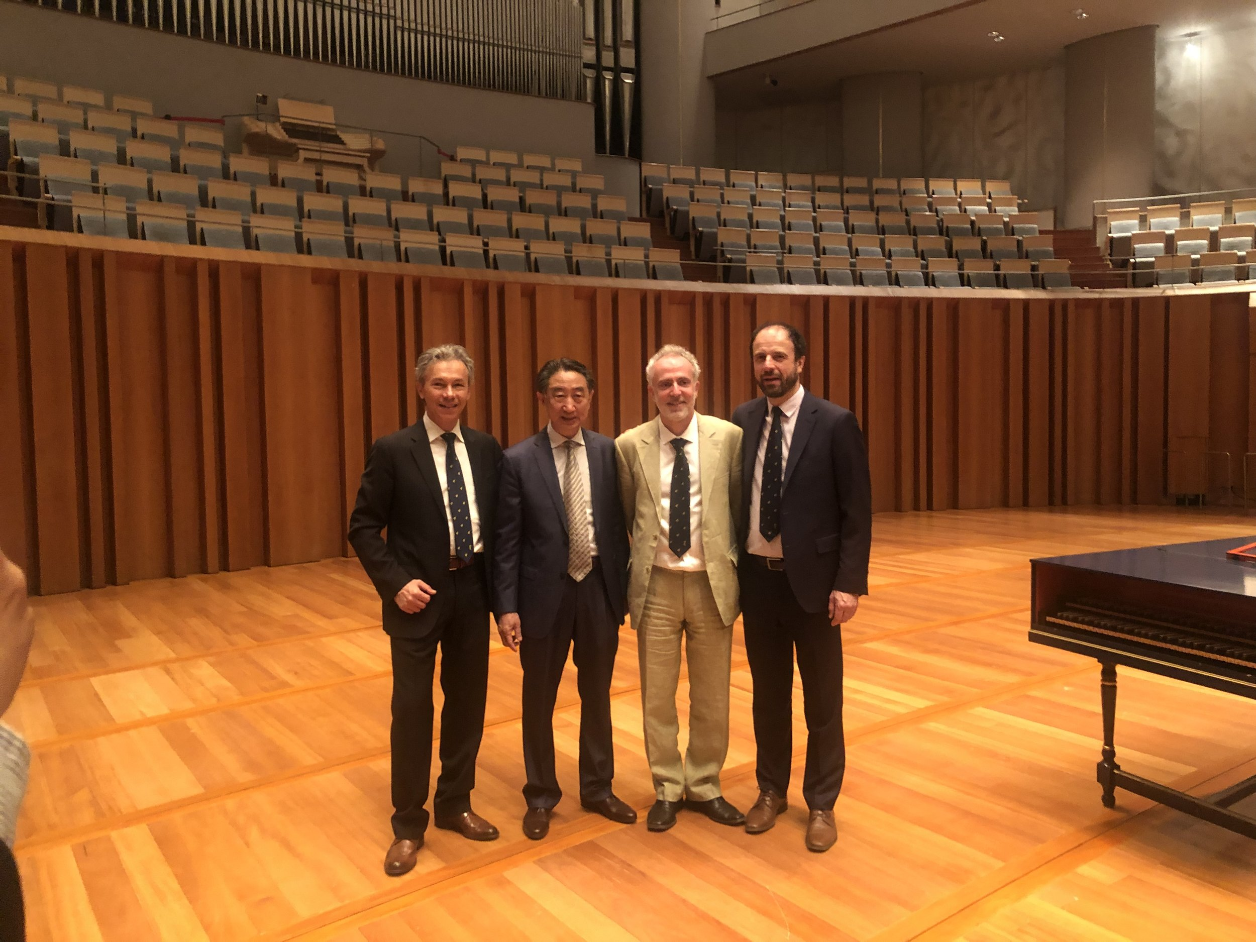 Zheng Quan with Simeone Morassi, Pierre Caradot, and Olivier Perot at the 4th China International Violin and Bow Making Competition