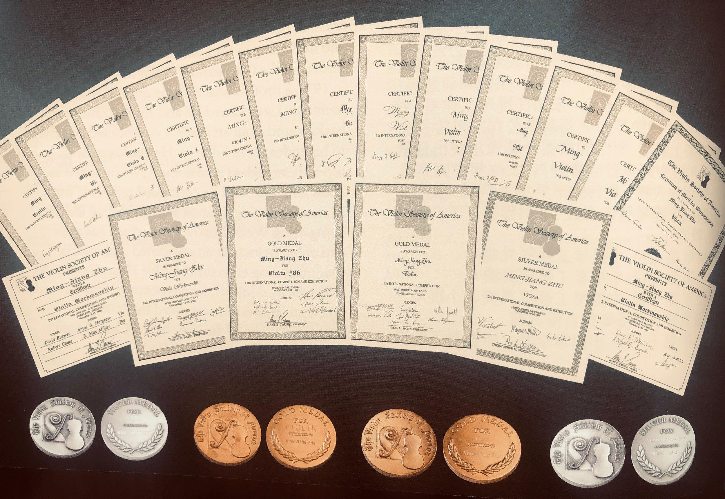 Awards from the violin society of america (vsa0 competition awarded to master chinese violinmaker Ming-Jiang Zhu (朱明江)