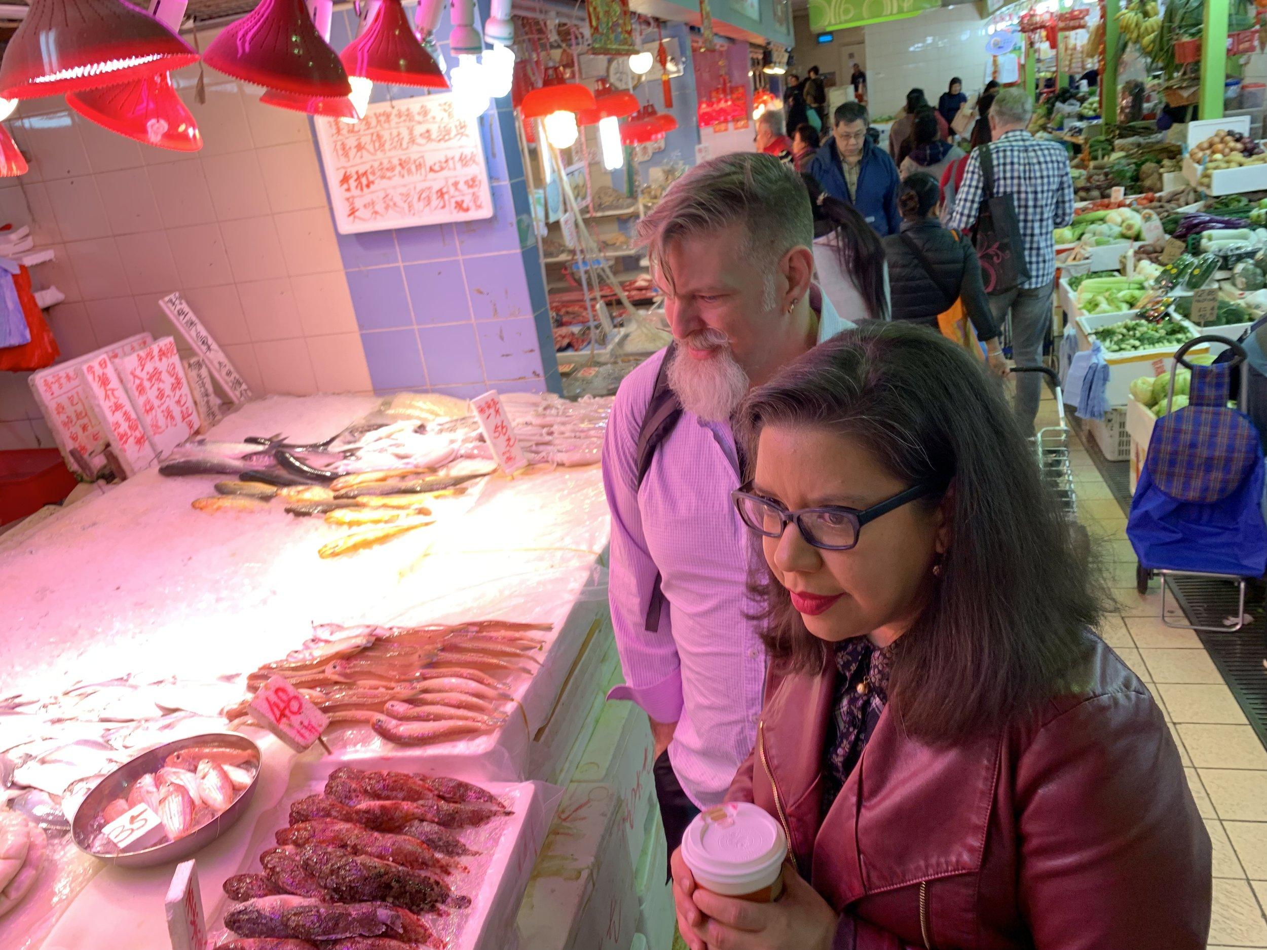 Erika and Devon teaching for ingredients in Macau's markets