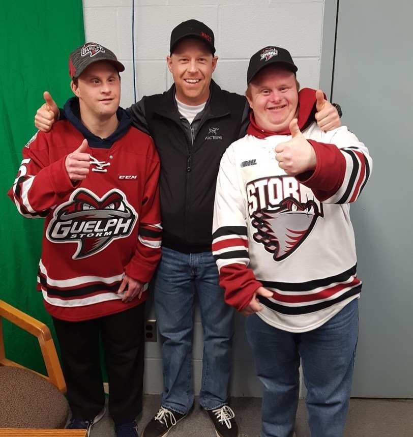 Kyle Aitken joined by two of the Guelph Giants Athletes.