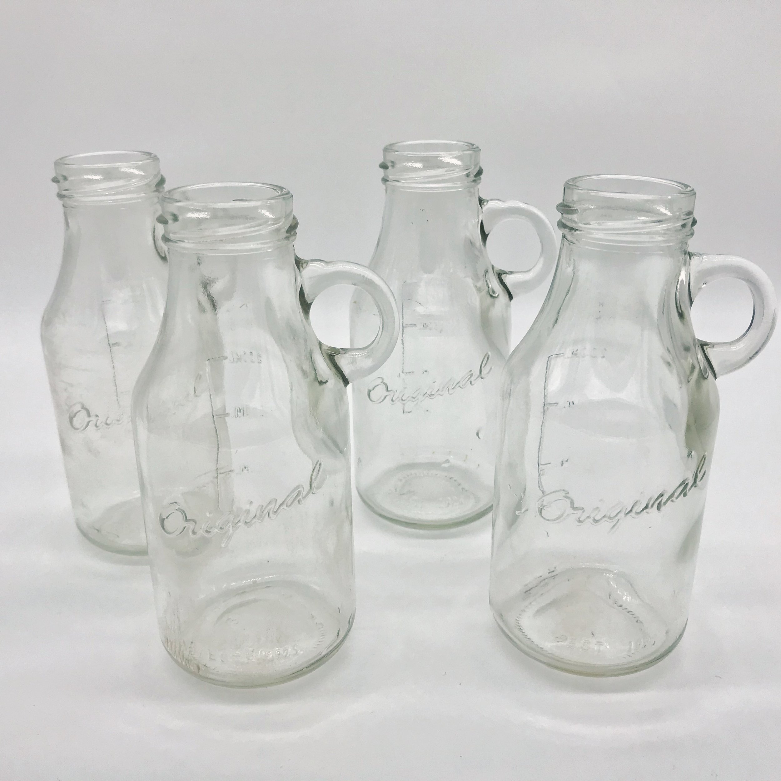 Vintage milk bottles  Price: $0.50  Qty: 9