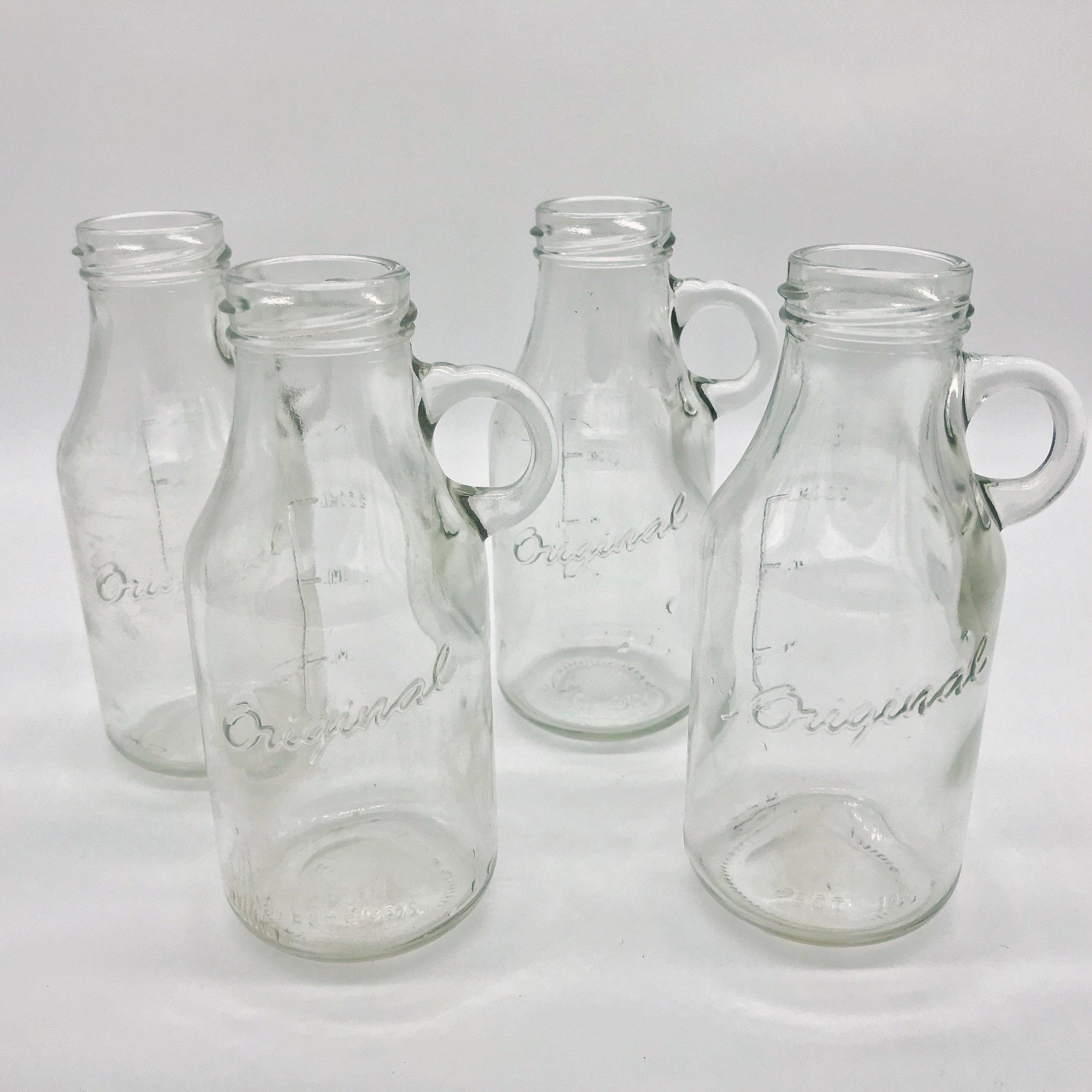 Vintage milk bottles  Price:$0.50  Qty: 9