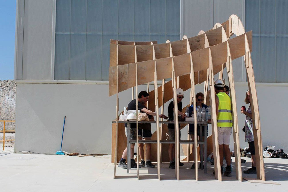 Team assembling the pavilion structure.