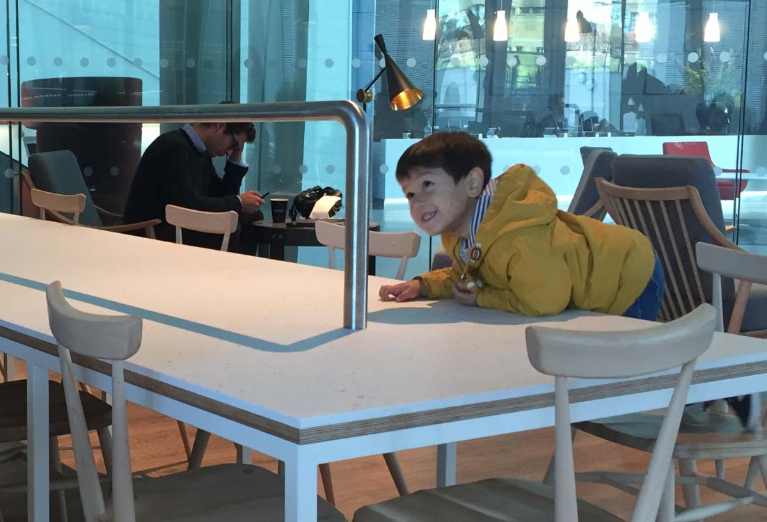 Carefully observing our bespoke table.