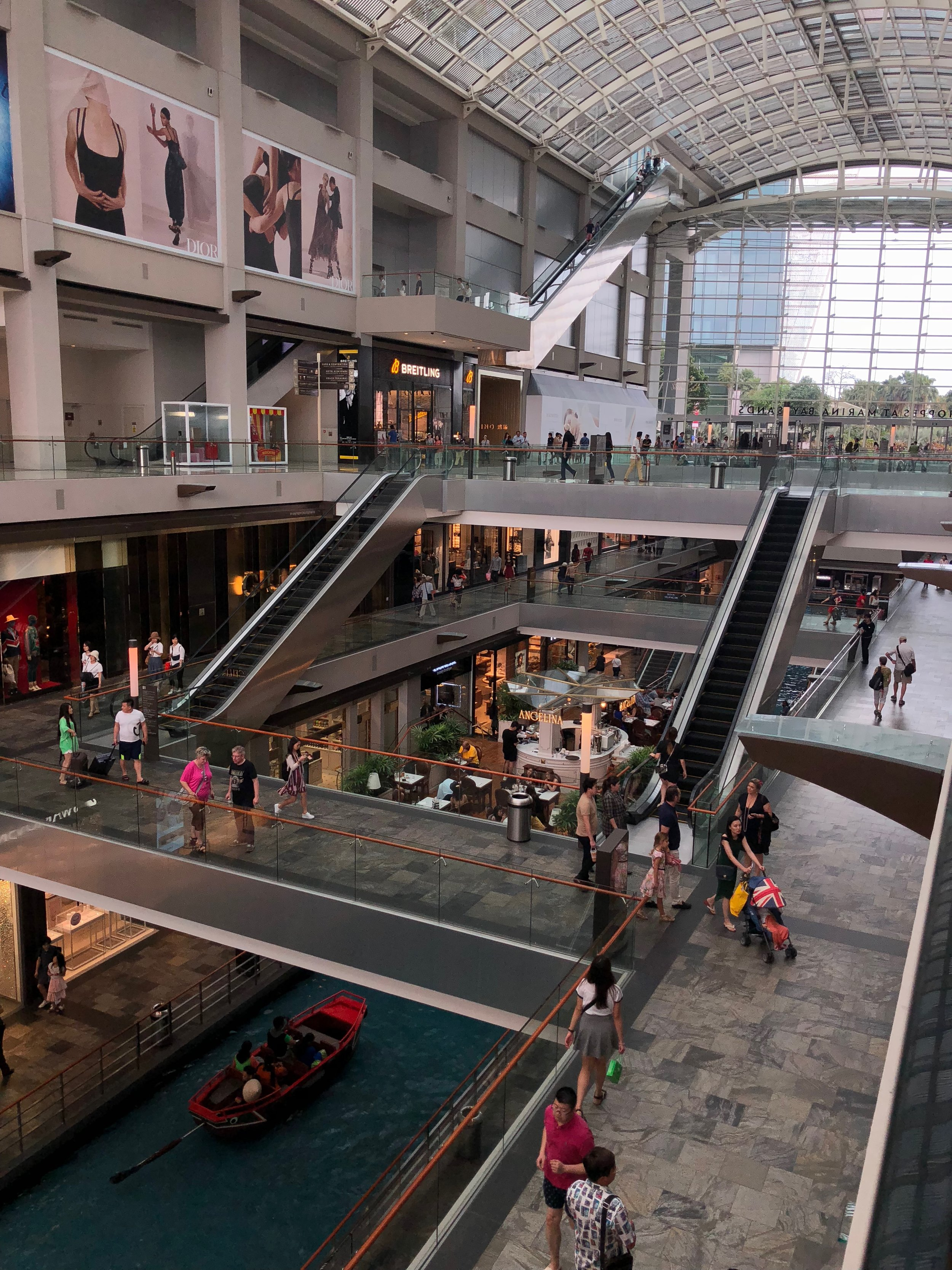 """Inside The Shoppes at Marina Bay Sands. If you look towards the bottom, there is a """"canal"""" that you can ride gondolas in. I could get a break from the humidity inside the The Shoppes, but the luxury stores did not seem budget traveler friendly."""