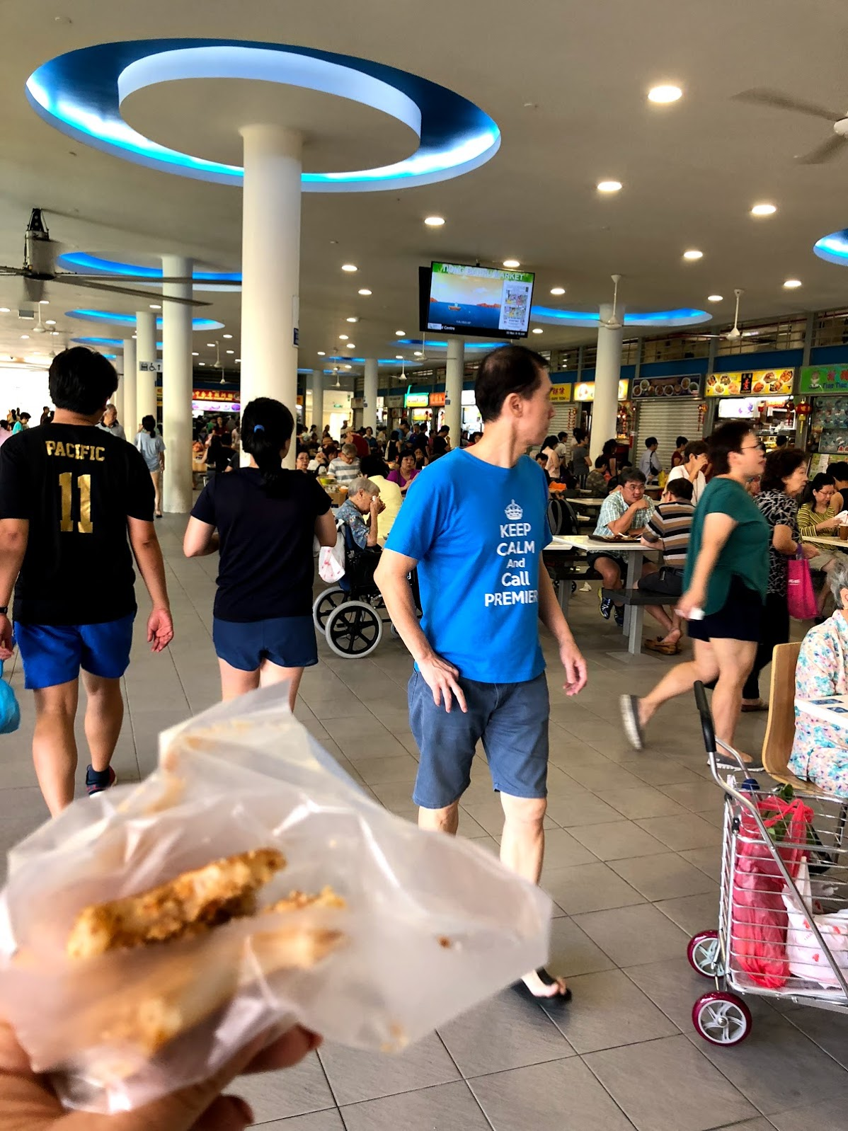 The Singaporean carrot cake is kind of blurry but this picture is also a good view of the liveliness of the hawker centres.