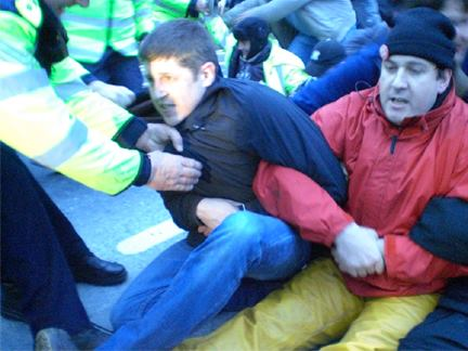 Me being removed by the Gardaí from the road outside the Shell refinery site in Ballinaboy, Co Mayo. I witnessed the Gardaí kicking, punching, crushing and using batons on dozens of entirely peaceful protesters at different protests over the course of several months. A Garda deliberately bend my own thumb backwards until it dislocated during one such protest.