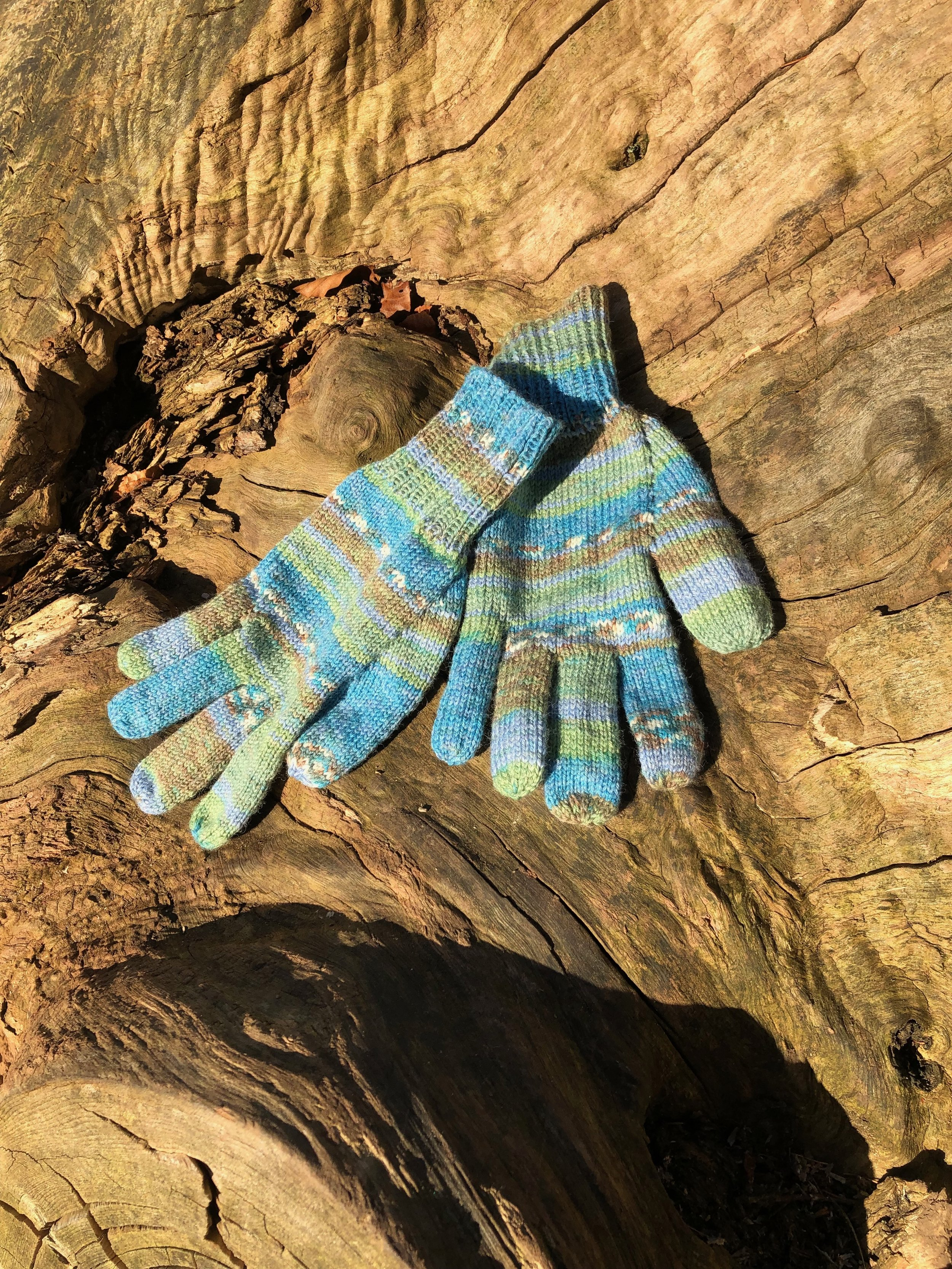 Gloves knitted using  Opal Sport