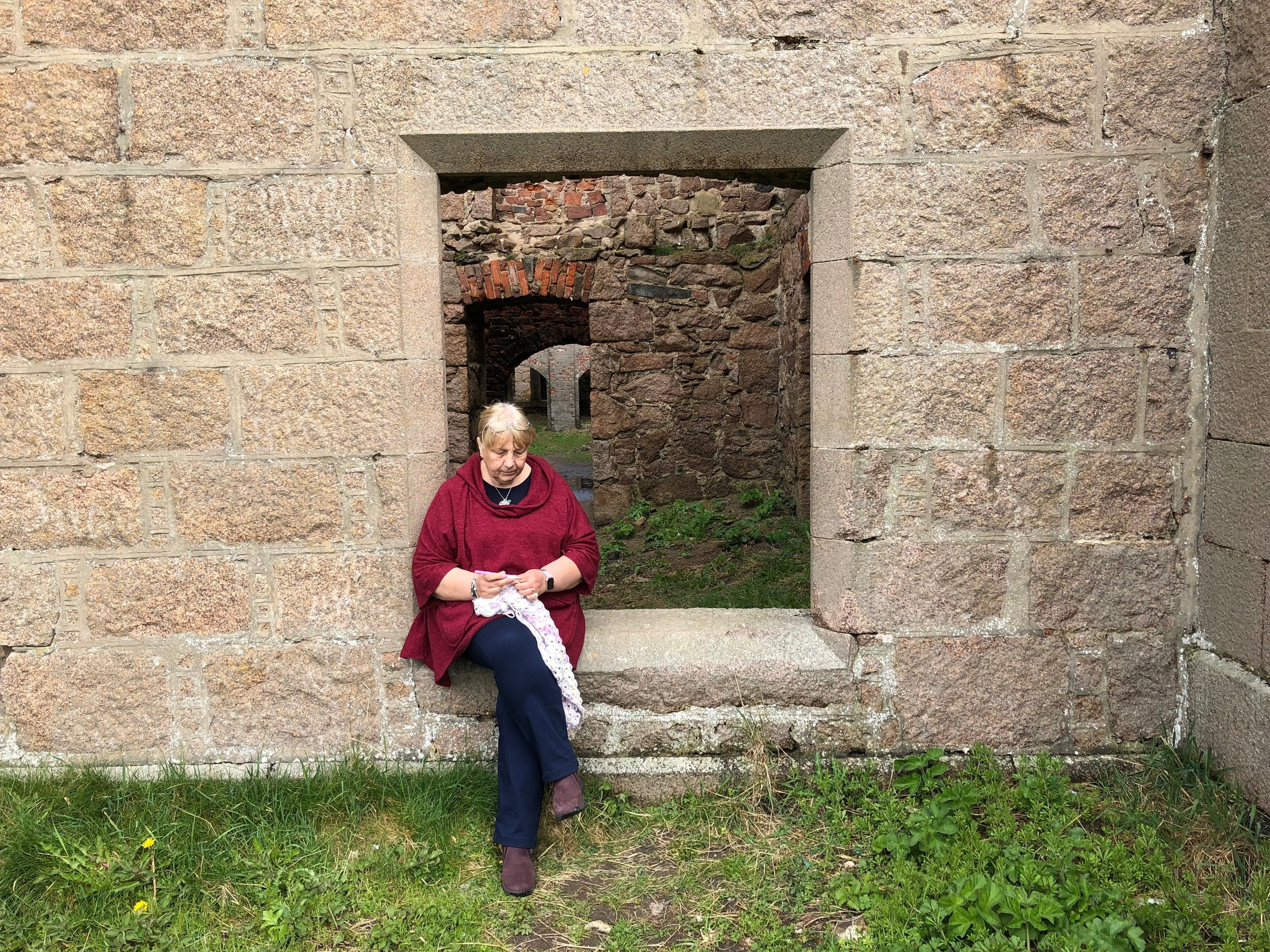Ali crocheting on holiday in Orkney
