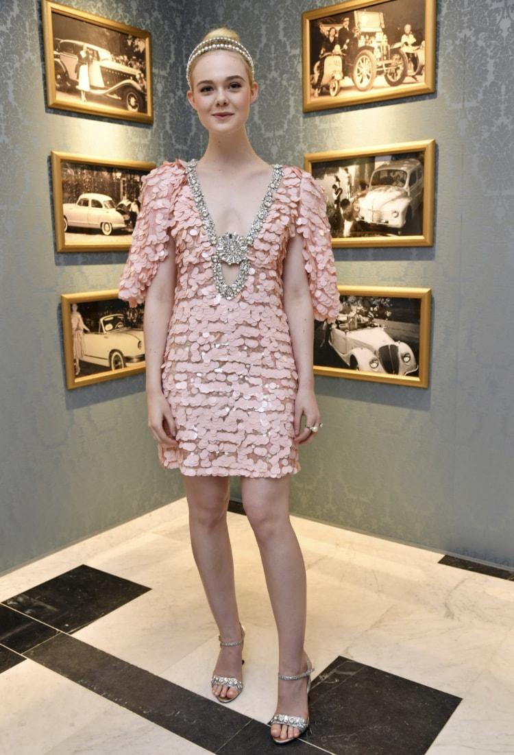 Elle Fanning wearing Miu Miu to a Miu Miu Event in Paris.