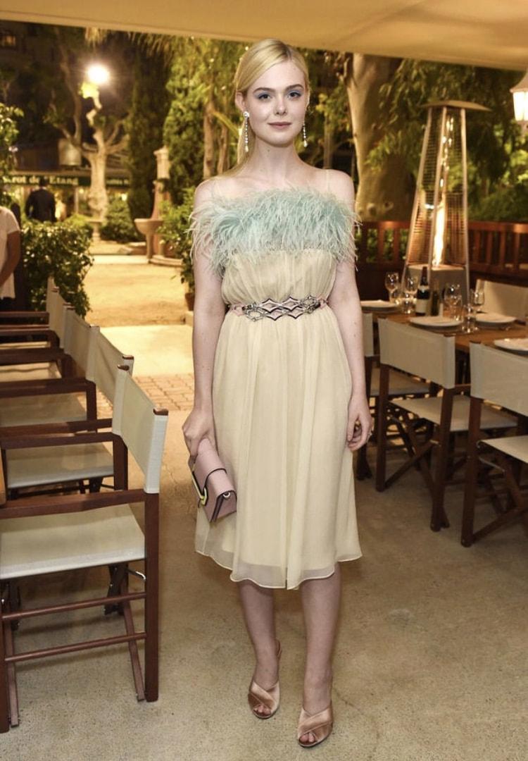 Elle Fanning attending the Cannes Prada Dinner wearing Prada.