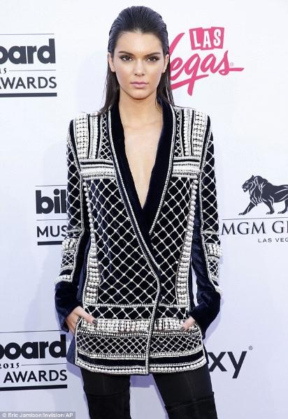 Kendall Jenner wearing a pearl blazer
