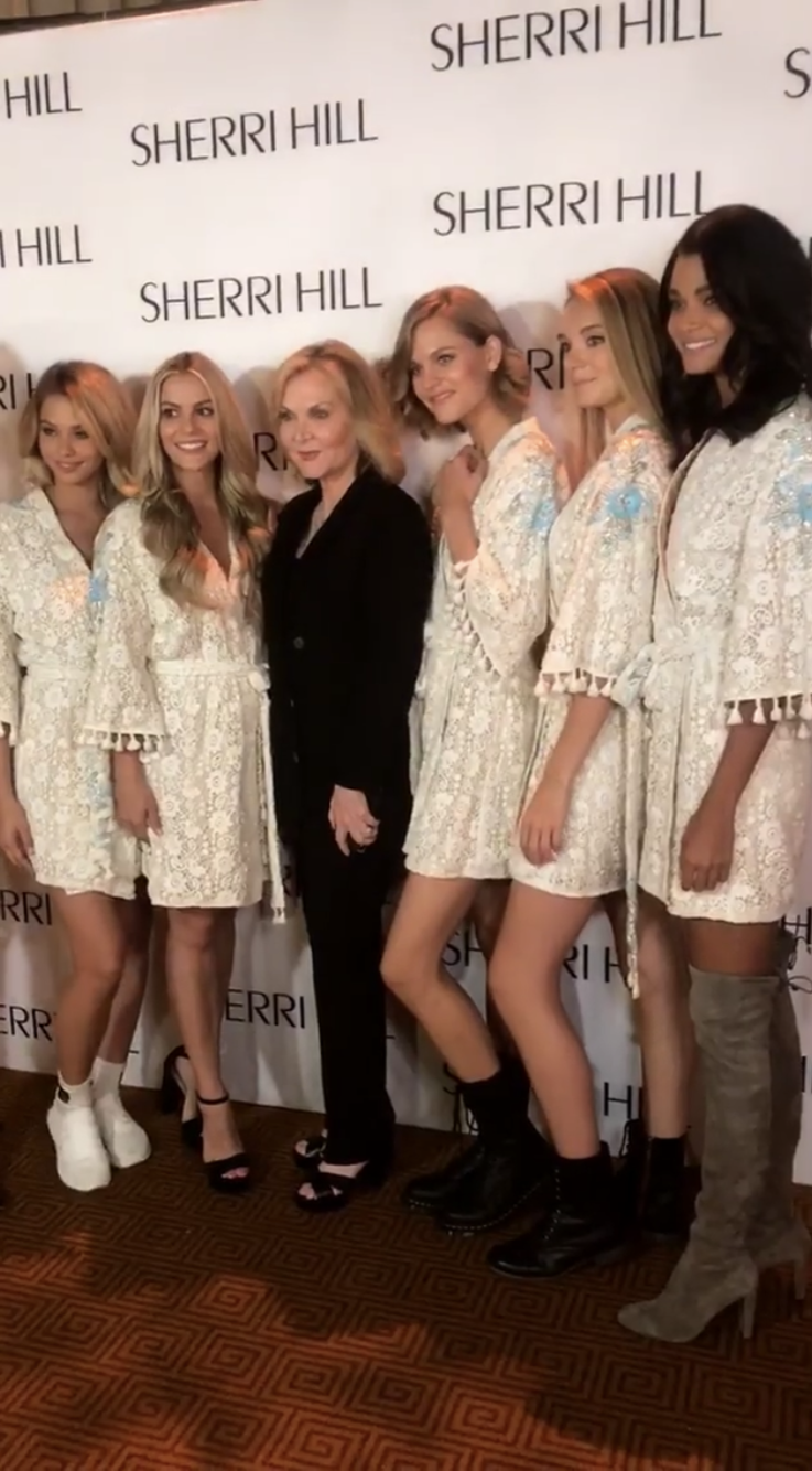 Sherri Hill (center) backstage with models.