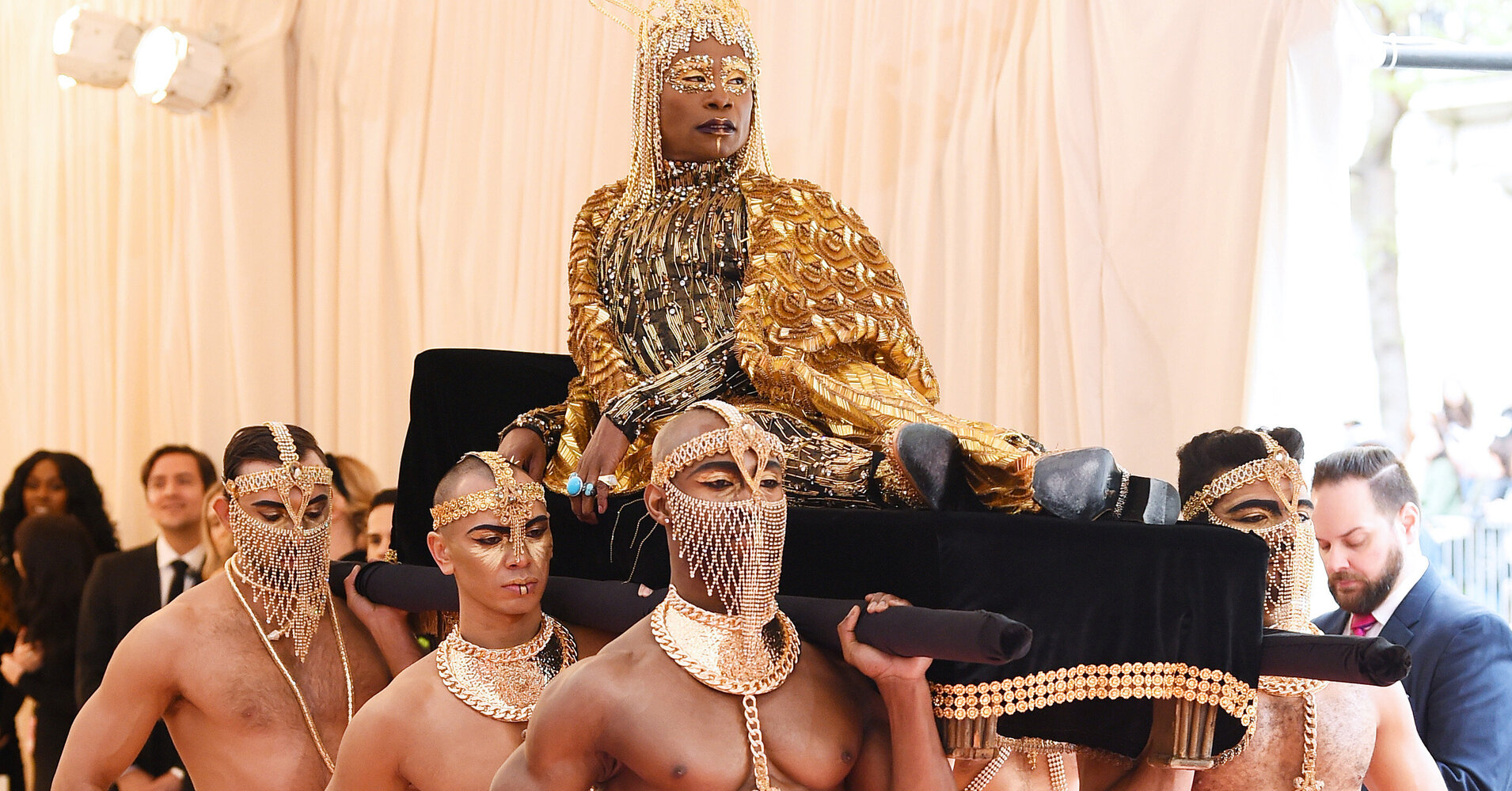 billy-porter-arrives-at-the-2019-met-gala-carried-by-shirtless-men.jpeg