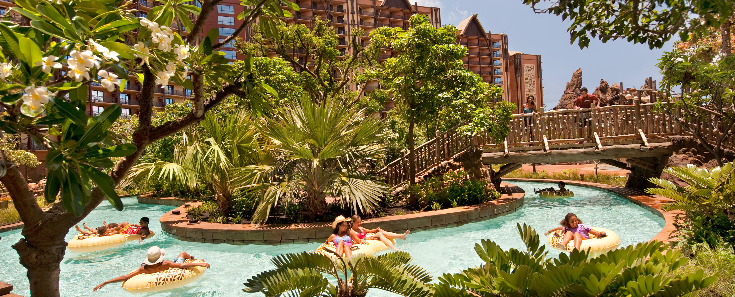 aulani-pool-area-girls-tubing-on-waikolohe-valley-lazy-river.jpg